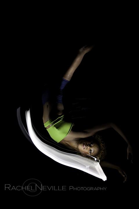 lying down dancer legs in air crossed photo by Rachel Neville