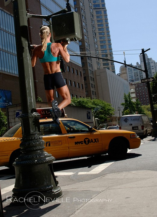 chin ups on nyc light post stoplight fitness photo women hangs from street light