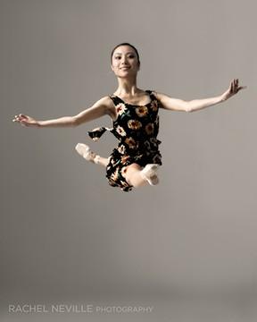 dancer jumping jete in sunflower dress Rachel Neville Photography