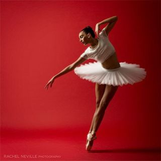 NYC dance photographer Rachel Neville classical ballet clean lines red background