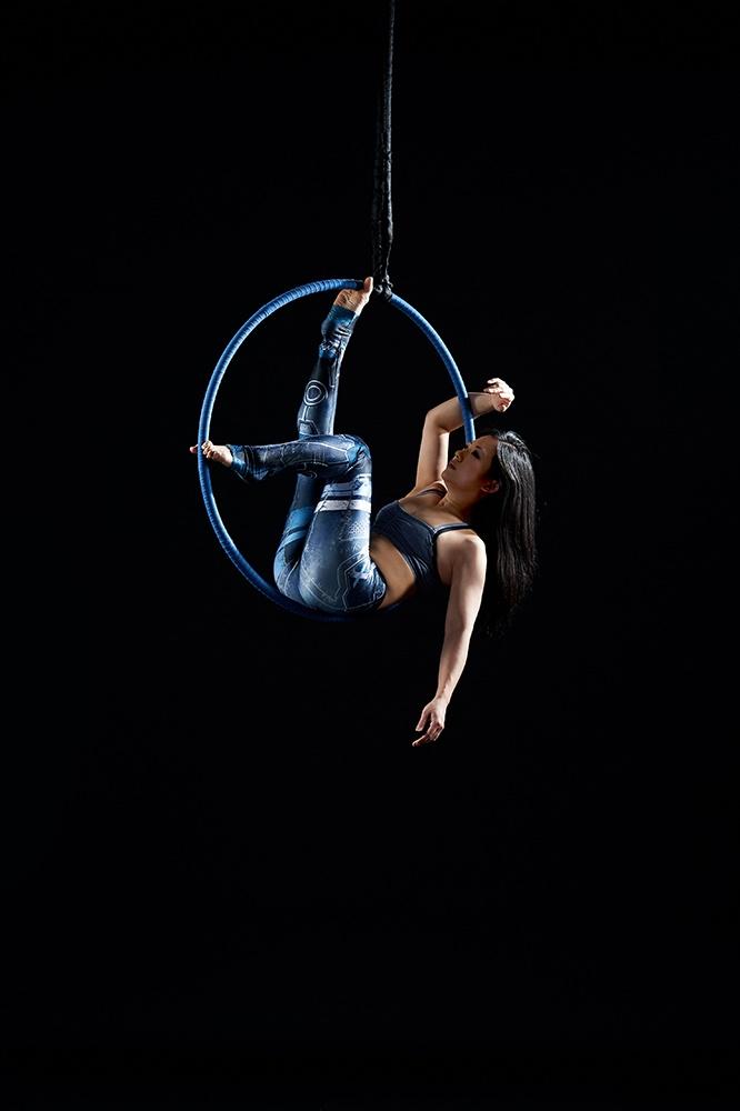 studio photos aerial hoop black background blue