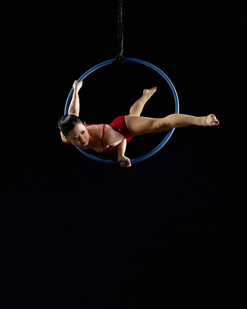 aerial photo Rachel Neville red leotard blue hoop